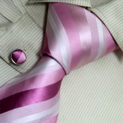 A tie with pink and grey stripes
